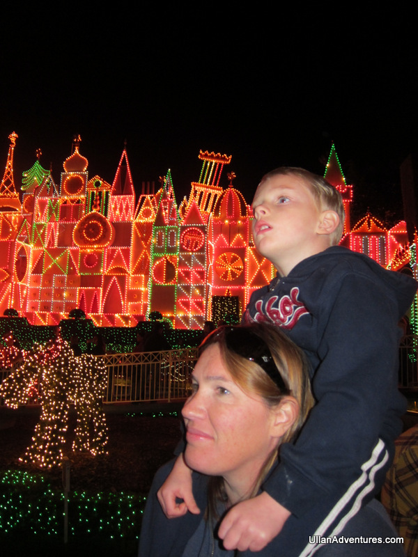 Watching the parade in front of Small World