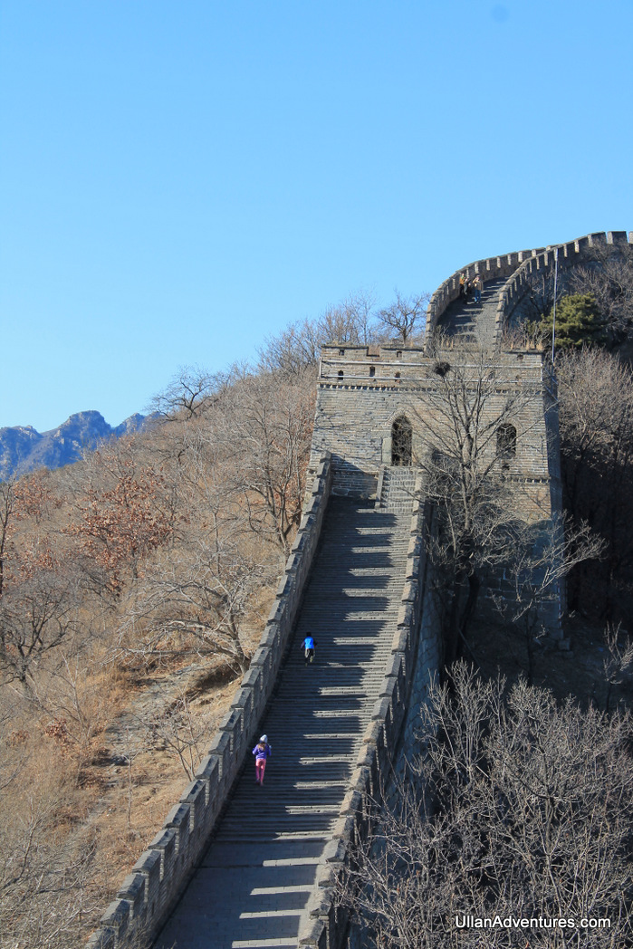 Beck and Mara running on the Great Wall of China