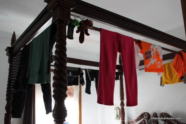Hanging our clothes to dry overnight on our 4-poster bed