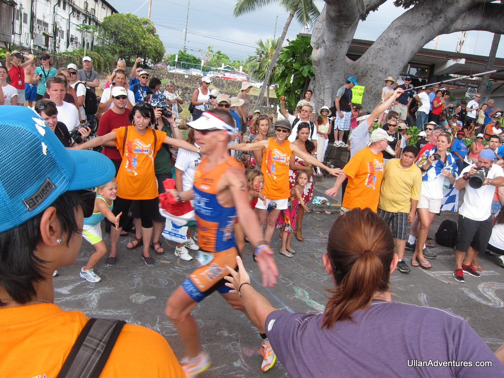 Me high fiving one of the top finishers as he finishes the race